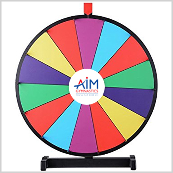 Spinning wheel with AIM Gymnastics logo to represent the prizes families can win when they refer a friend for recreational gymnastics classes in Ajax and Pickering.